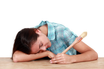 Woman with a brush sleeping on a desk
