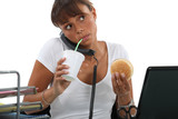 woman eating and drinking while making a call