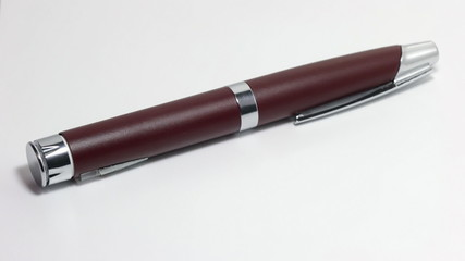 Hand puts the pen
