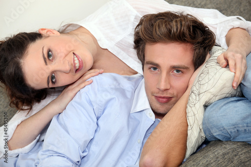 Couple hugging on a sofa