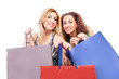Happy women with shopping bags - copy spaces