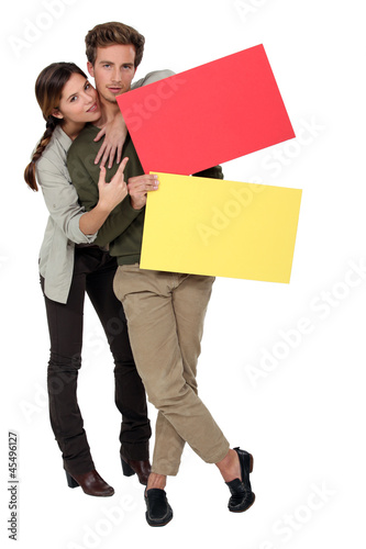 Couple with red and yellow blank cards