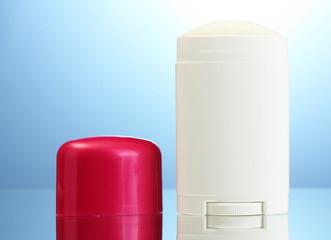 deodorant on blue background