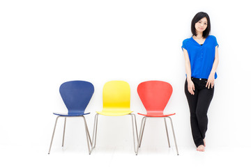 a young asian woman with colorful chair