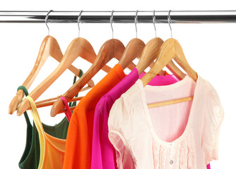 different clothes on wooden hangers isolated on white