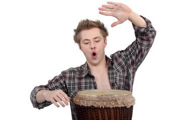 Enthusiastic man playing the bongo drum