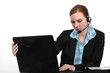 pretty receptionist with laptop and headset