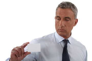 mature businessman holding business card