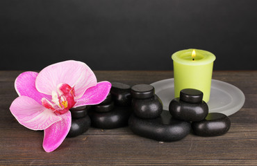 Spa stones with orchid flower and candle