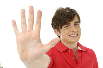 Young man holding up hand, focus on hand