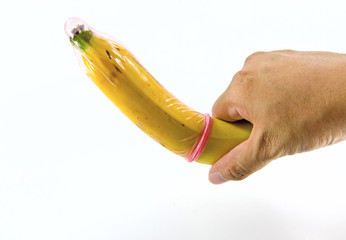 Condom on banana in hand