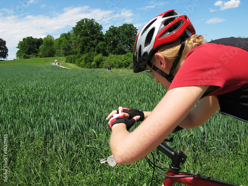 Young woman riding a mountain bike