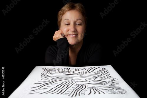 Artist admiring her work