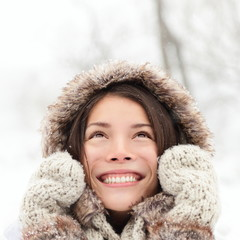 Winter woman looking up happy and smiling
