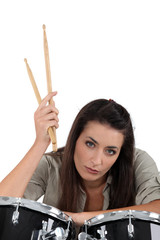 female musician posing with drums