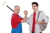 Experienced tradesman making a pact with his new apprentice poster