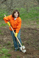 woman works with spade in  garden