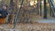 Happy boy swinging on a swing in autumn