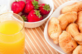 Breakfast with berries,orange juice and croissant