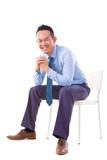 Asian businessman sitting on a chair