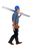 Man carrying metal beam