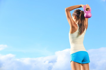 Fitness woman using kettlebell outside