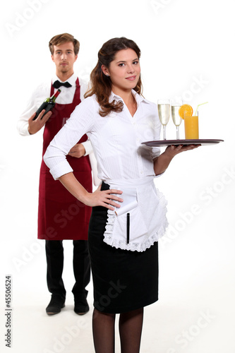 Waiter and waitress with a drinks tray