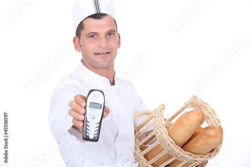 Baker with basket and phone