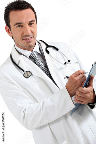 Doctor writing on clipboard smiling