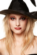 Beautiful blonde in a witches hat