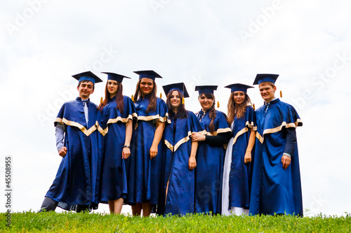 Group of happy young graduates