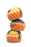 A stack of chocolate vanilla muffins on white background
