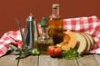 tavola rustica con  pane, pomodoro ed olio d'oliva