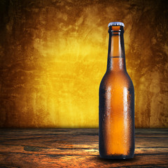 Bottle of beer on grunge background