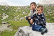 Portrait of two brothers outdoors in the mountains. Dolomites