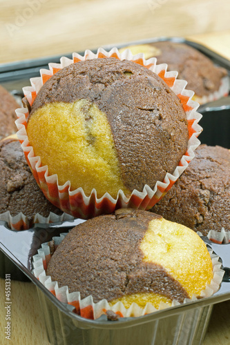 Chocolate and vanilla muffins in paper cake cups