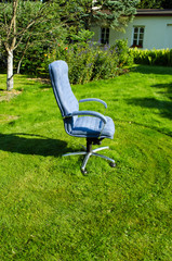 Boss chief office chair in garden lawn grass cut