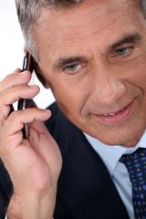 Mature businessman with a cellphone