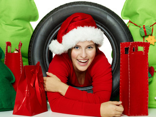 Miss santa with tire and presents for christmas