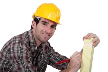 portrait of carpenter looking happy