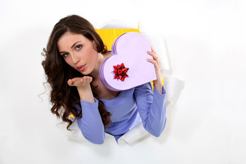 Woman with a heart shaped box of chocolates
