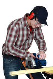 craftsman cutting wooden board