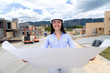 Civil engineer holding blueprints