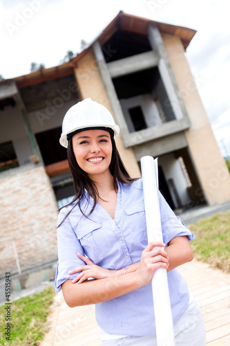 Civil engineer with blueprints