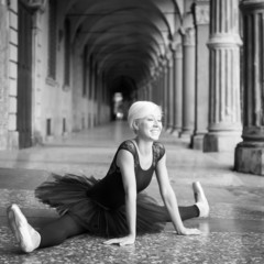 Young beautiful ballerina relaxing out in the street.