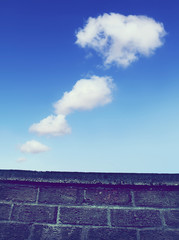 clouds over wall