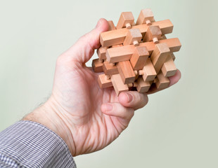 Wooden puzzle in hand