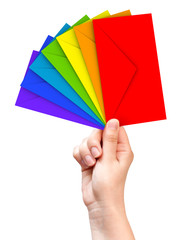 Colorful envelopes in the female hand isolated