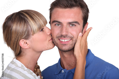 Young woman kissing a man's cheek