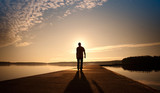 A man goes on the concrete pier in the sunrise - Fine Art prints